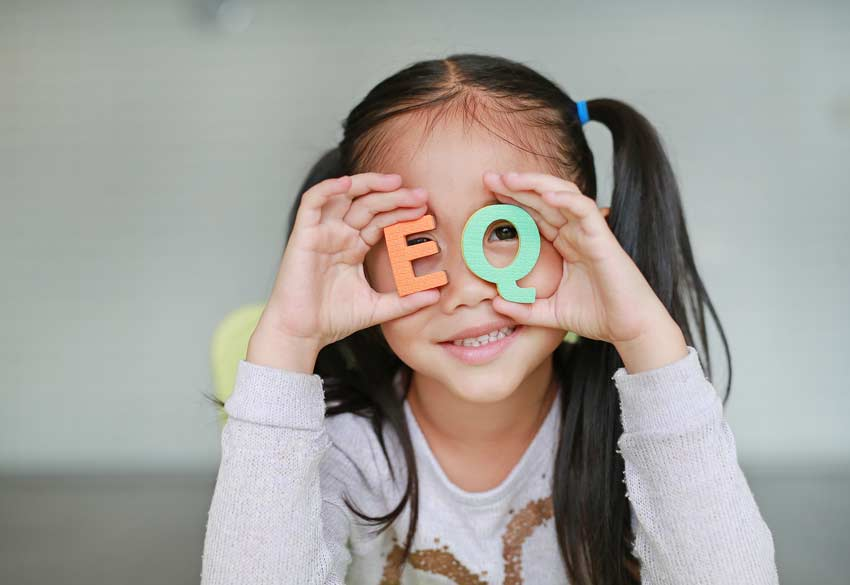 girl playing with letters